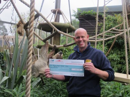 Mark_with_Sidone_the_sloth_at_Drusillas_Park_and_the___1000_grant_from_JCS_Livestock.JPG